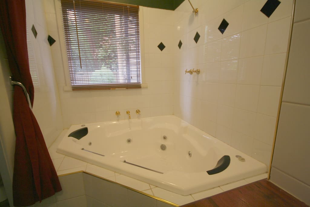 Large corner spa bath