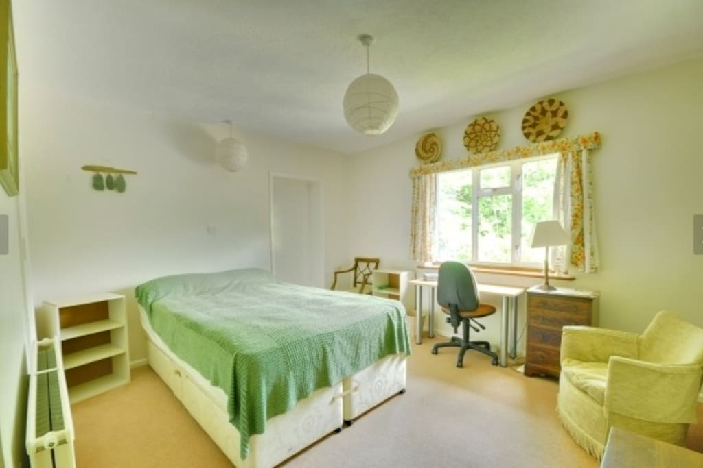 Large room with natural light and views. Very peaceful.  Private ensuite is also bright and clean.   Plenty of built in storage and a comfortable bed.  Now has new green wool carpet and has been redecorated. New photo coming soon.