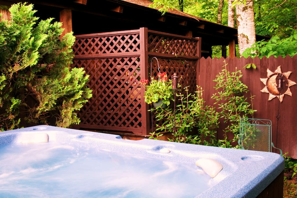 Large outdoor private hot tub just off your own private porch by the creek
