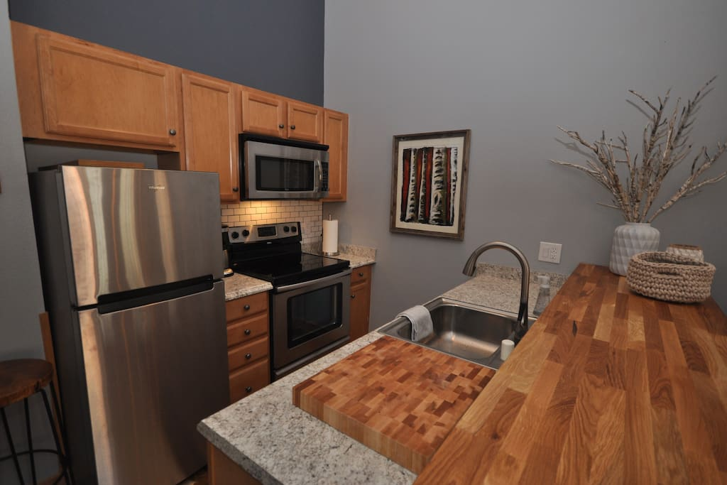 Extended bar for dining, stainless appliances and all necessary kitchen items (blender, toaster, coffee machine, etc)