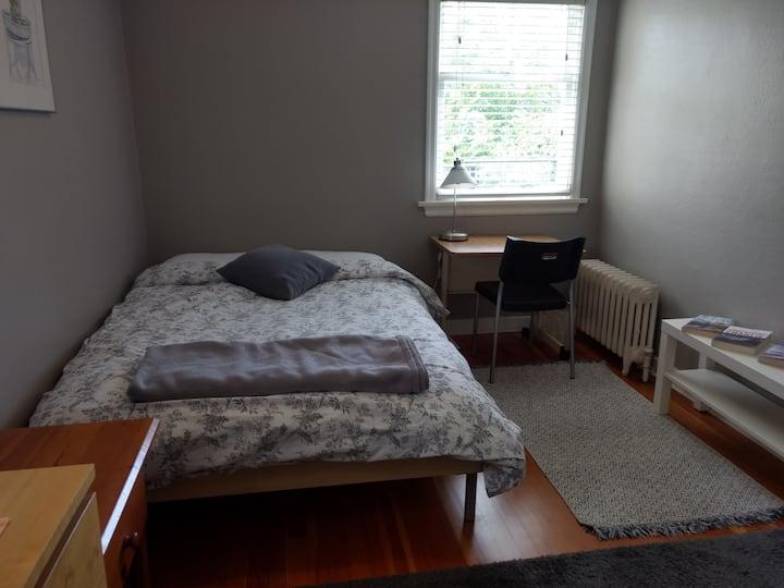 Bright & modern main floor bedroom in quiet home.