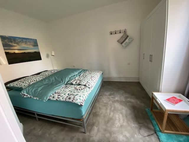 Huus Utspann Schlafzimmer mit Doppelbett