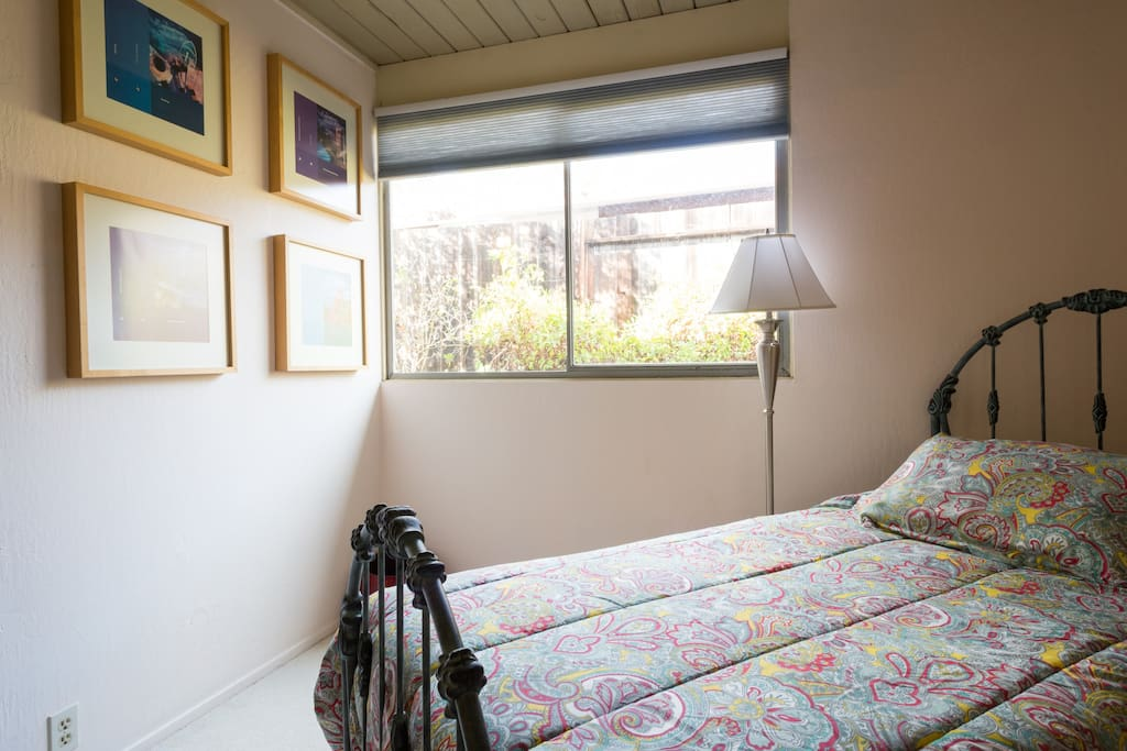 Light and airy room overlooks the side yard. Sky views at night are lovely.