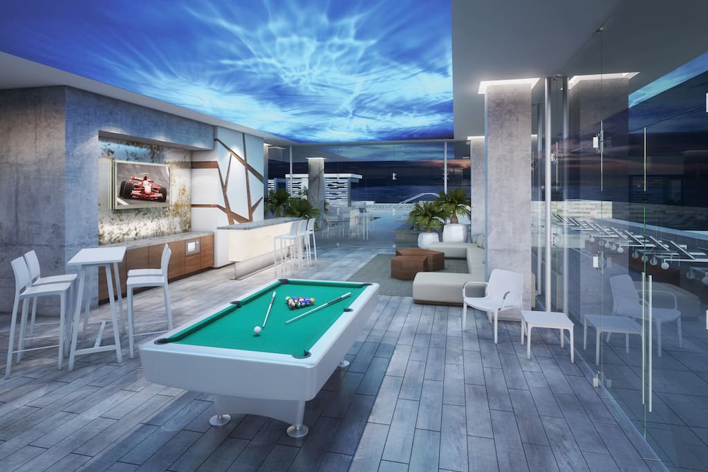 You won't want to leave Loft 268 once you set foot in the luxurious rooftop area.  Enjoy the large infinity pool with waterfall, gym, glassed Sky Bar, BBQ area, fire pit, Jacuzzi and plentiful sunning areas.