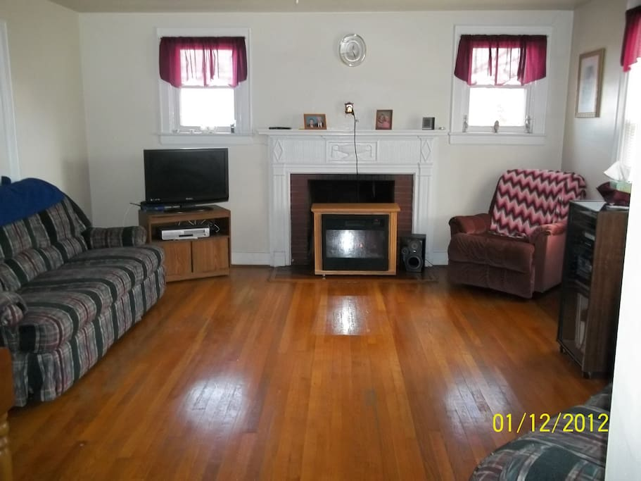 Open living room with hardwood floors.