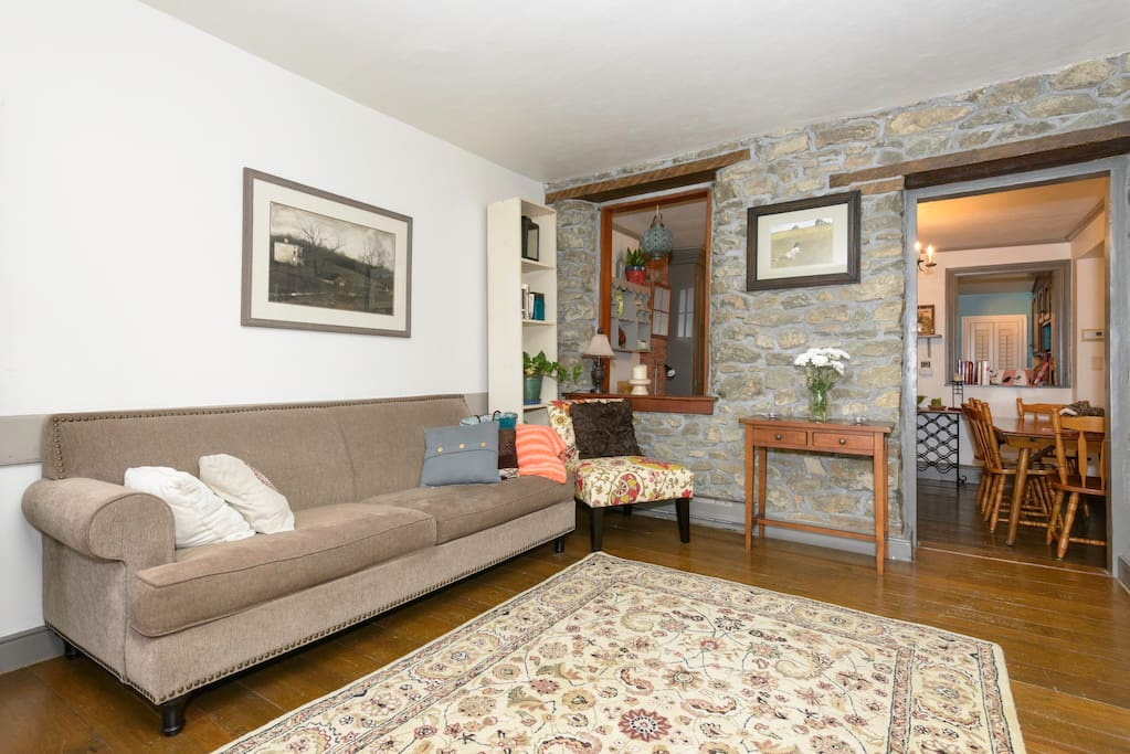 Living Room with original stone wall