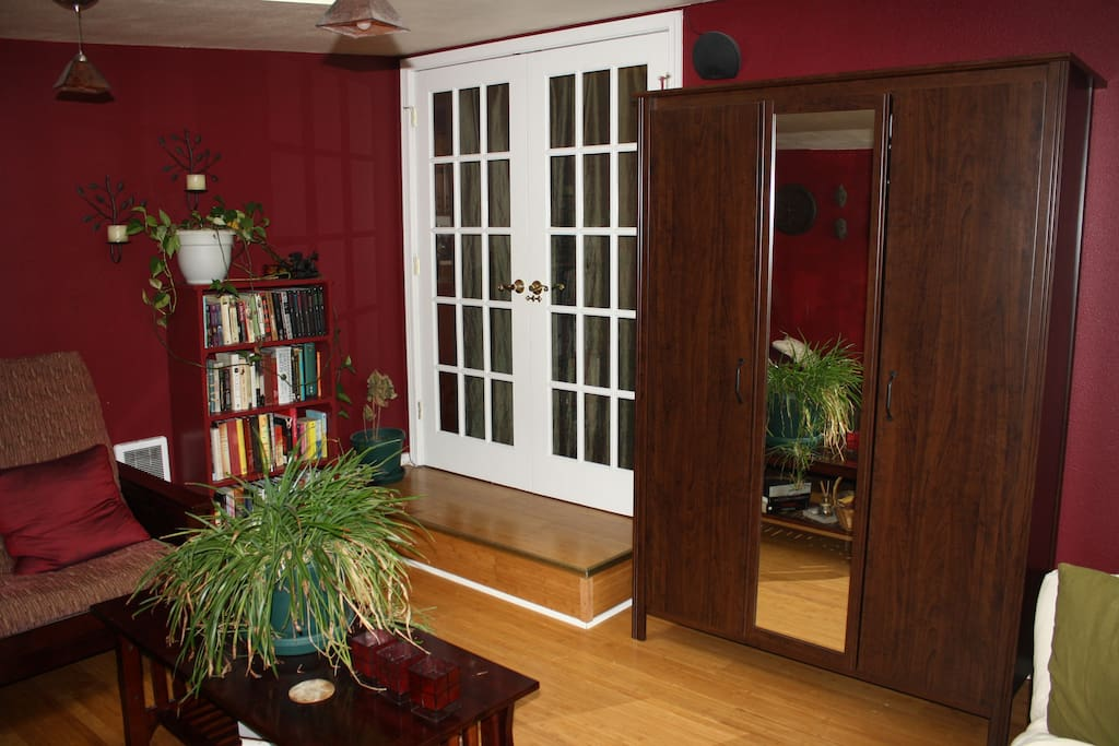 Large wardrobe with full length mirror for your use. French doors lead to dining area and kitchen.