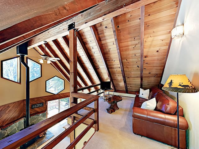 Upstairs, the loft provides an additional living area with a view of the living room below.