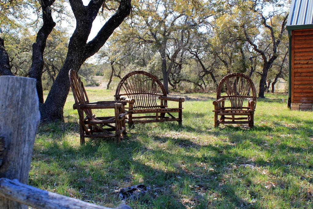 Relax in the sitting area under the oaks