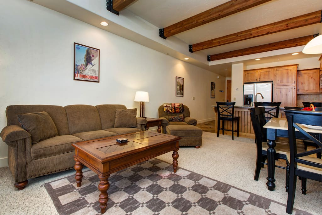 Open concept floor plan with exposed beam ceilings.