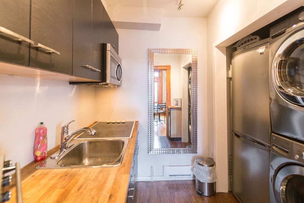 Fully equipped kitchen with front load washer and dryer inside the apartment (no dishwasher)