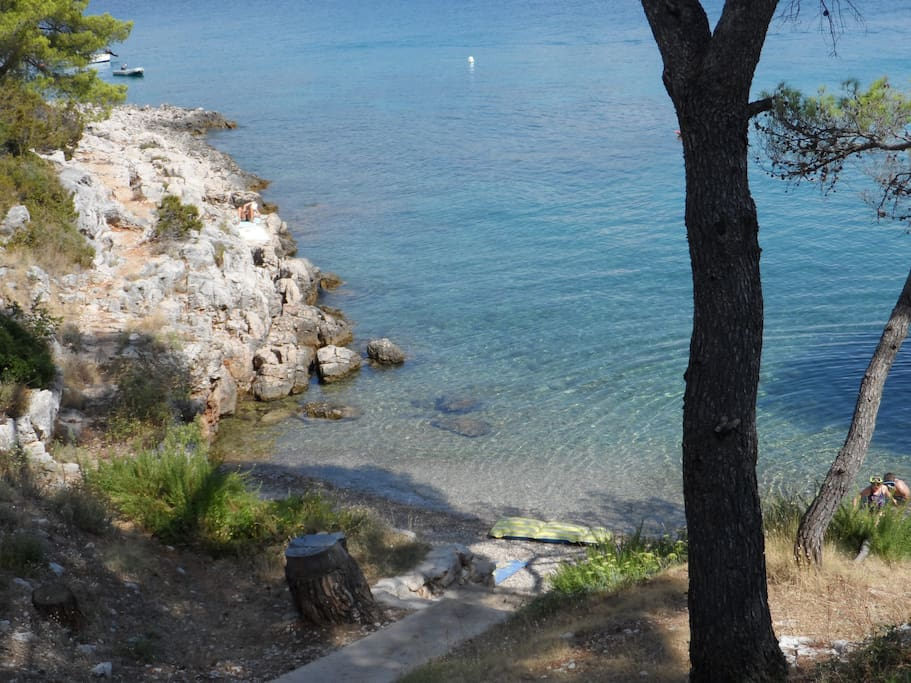 The small beach in front of the house