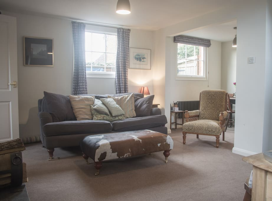 3 seater sofa and antique arm chair, also cushions for the floor.