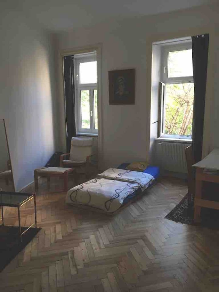This is your room, bright, quiet and clean with an old not cracking wood parquet, a bed with slatted frame and a simple but comfortable armchair with foot offshoot