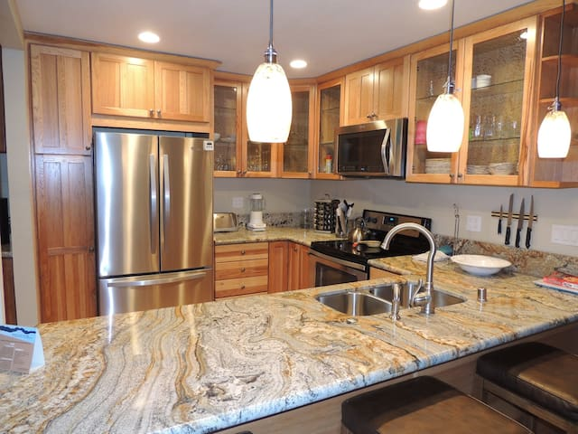 Kitchen with granite counter top, open concept