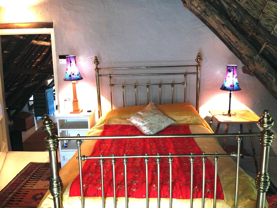 The antique brass bed.