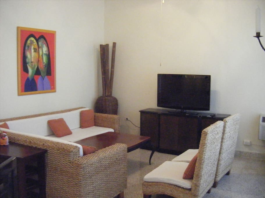 Living room area is air conditioned and sofa can accommodate an extra person if needed.