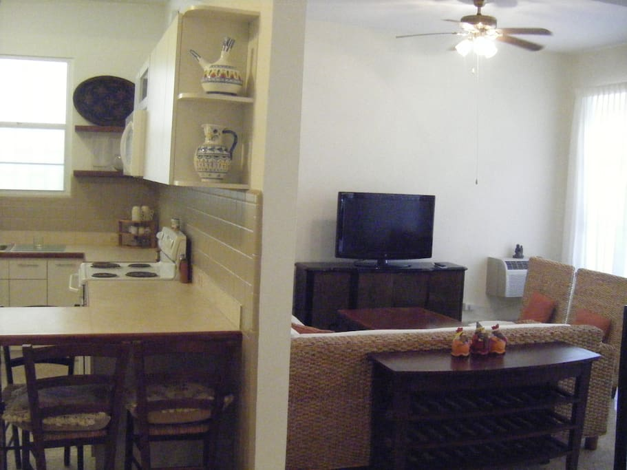 View to kitchen on left and living room at right.