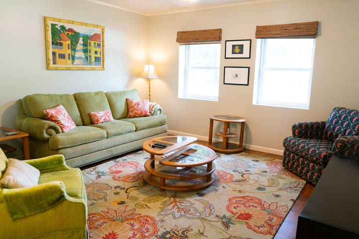 Family room with QUEEN pull out couch and large screen HD TV, WiFi access along with seating for the entire family.