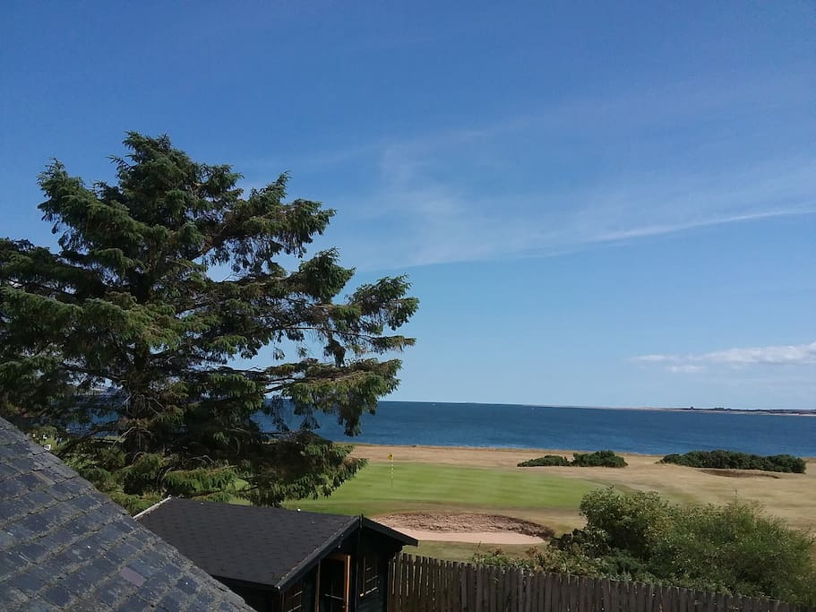 View of golf course/beach from patio