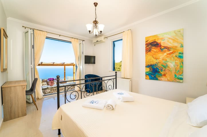 Ground floor double bedroom with direct to the pool area.