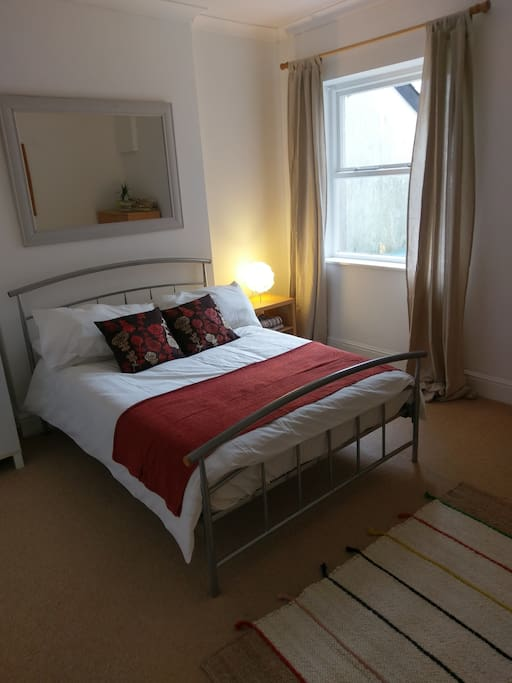 Bedroom 2 - double bed, wardrobe and chest of drawers