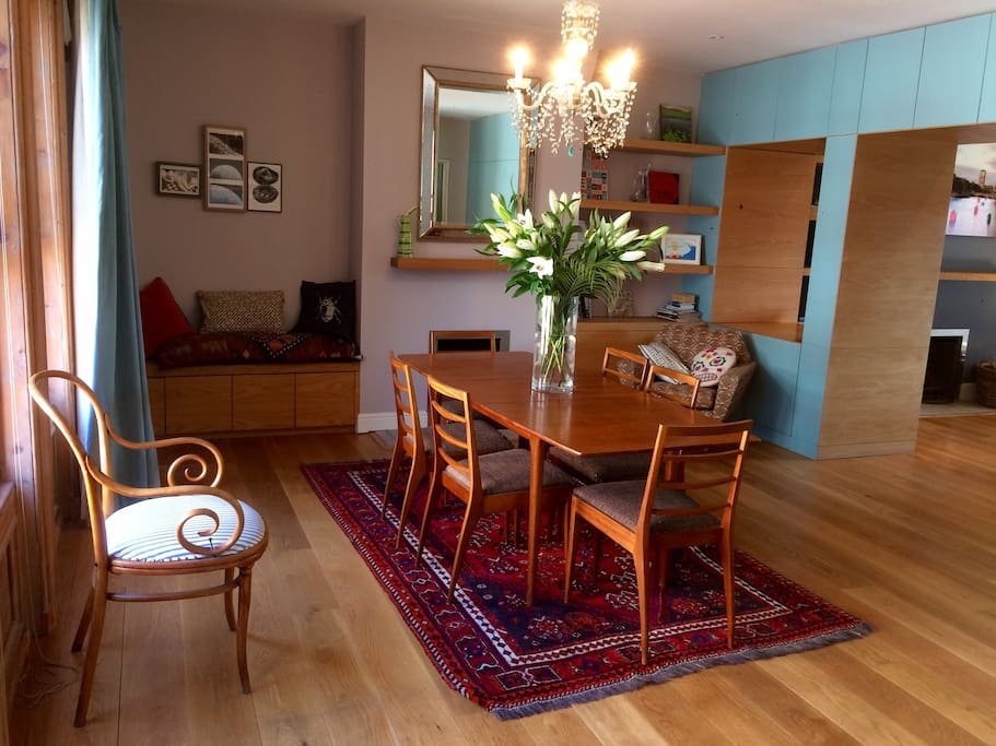 The apartment has an enormous open-plan living space encompassing a kitchen, dining area and sitting room.