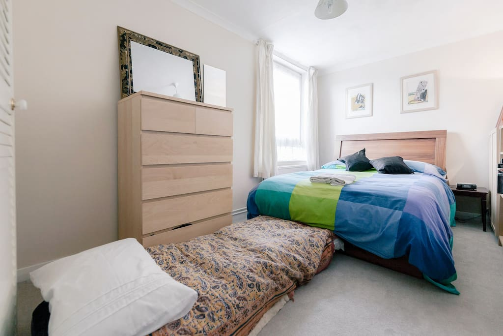 Large double room with 1 double bed + comfy single airbed. Sleeps 3 comfortably
