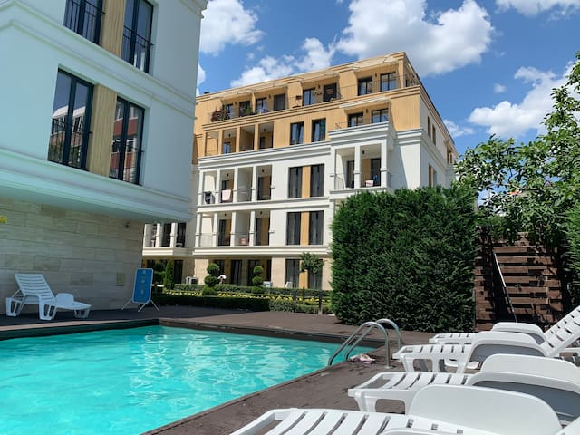 A luxury flat with an outdoor swimming pool