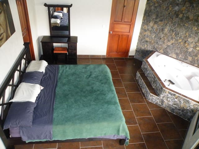The Master bedroom is equipped with a King size orthopedic bed
