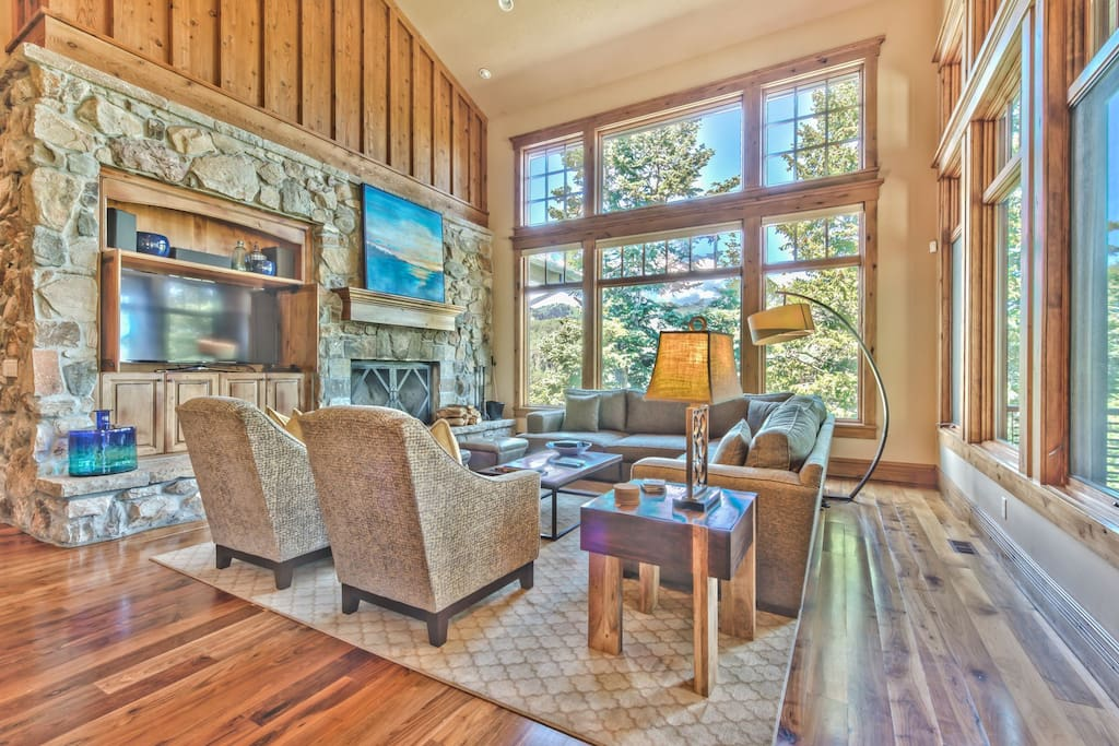 Living room with large HD TV/DVD, wood-burning fireplace, and private decks with 180 degree views of Park City and Deer Valley