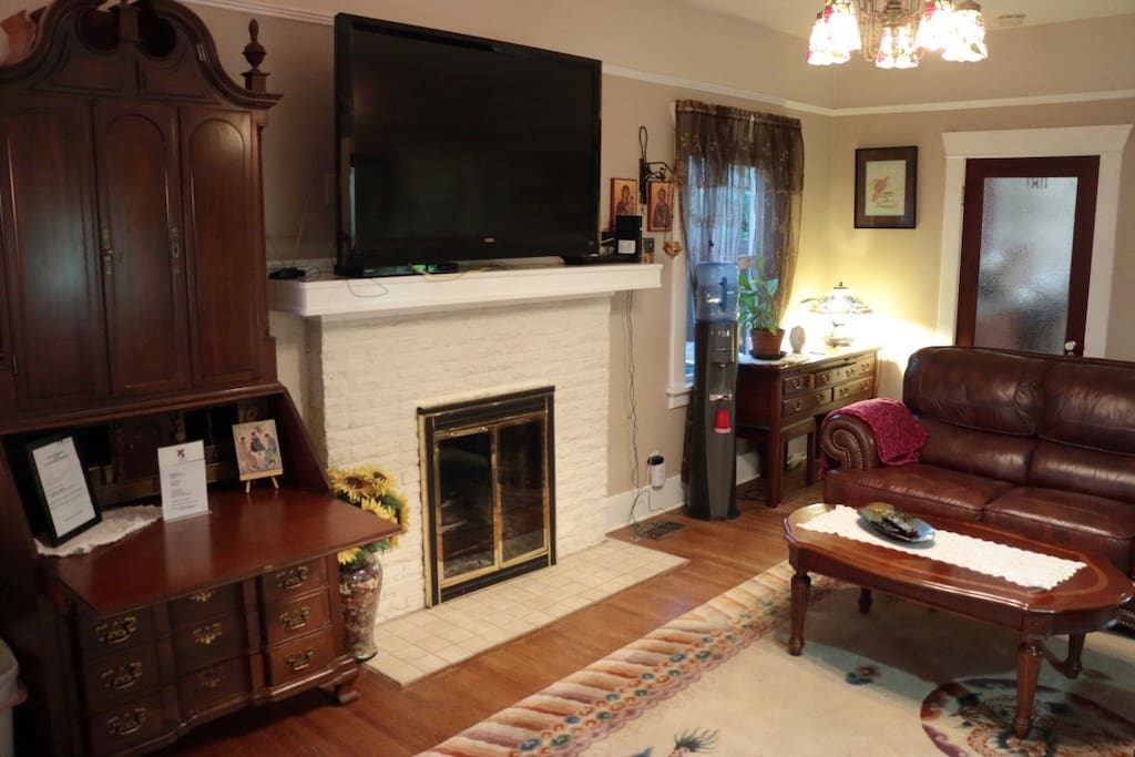 View from front door toward couch and HD large screen TV