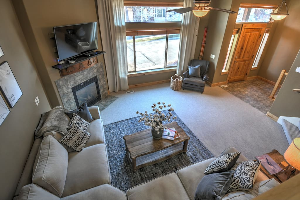 Main Level Living Area with TV and Gas Fireplace