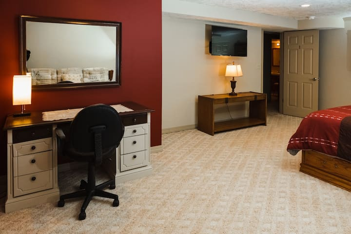 Spacious bedroom with a very comfortable King size bed, queen size hide a bed and office desk and chair nook.