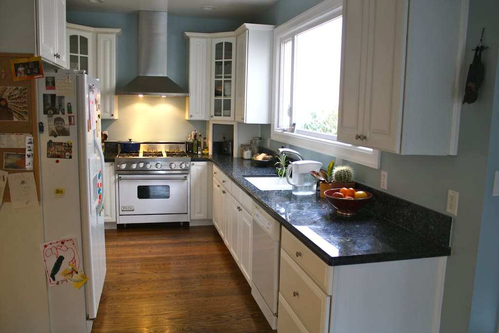 Fully-stocked kitchen with dishwasher and Viking stove