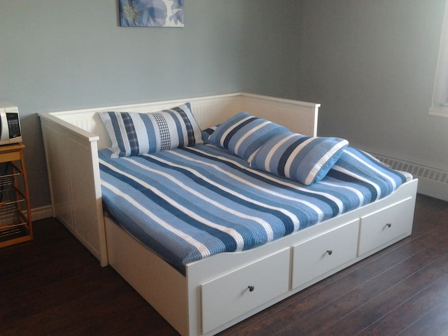 Ikea daybed opens up into a king sized bed.