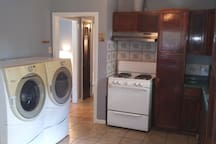 Washer and dryer includes full kitchen.