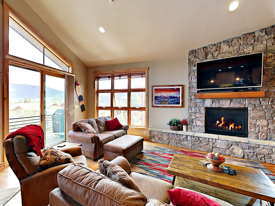 Enjoy mountain views from the rustic-luxe living room
