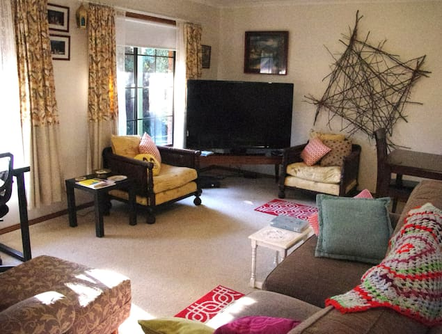 This is the lounge room with plenty of comfy places to sit and relax. The large screen TV is available for guest use with free to air. TV and a selection of DVD's. It is well-heated with a gas, wall heater and fans for hotter weather.