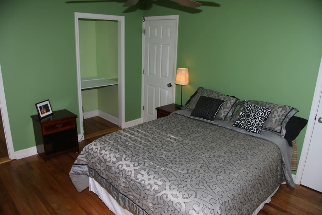 Relax in a spacey comfortable bedroom with a ceiling fan and closet space.