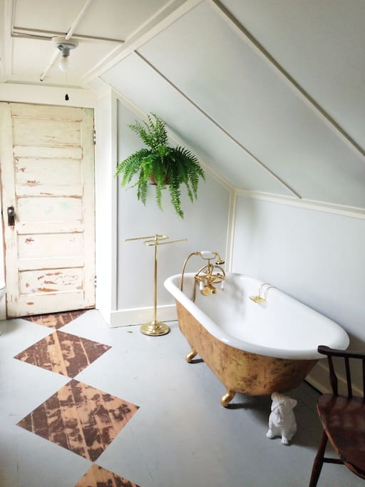 The bathroom!  Take a bath in our gold leafed tub.  There is no standing shower, just a hand held shower in the tub.