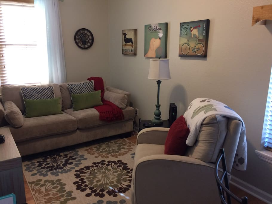Cozy, bright living area with deep comfortable couch