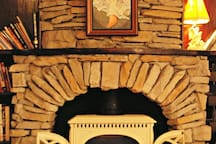The custom made fire place and painting by David.