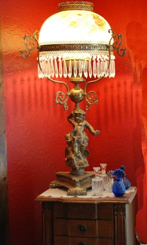 Beautiful antique lamp in the Master Suite. The house is filled with antiques.