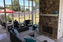 Screened in back porch with gas fireplace