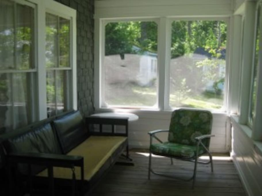 Screened in front porch.  Cabin located directly on calm lake.
