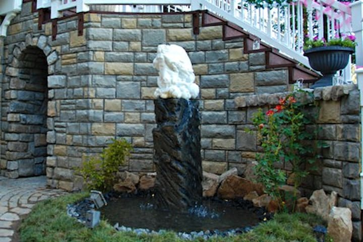 The fountain is an original sculpted marble piece by David.