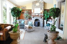 Our Sun Room. One of my favorite places. Sky lights and windows make you feel like your outdoors.