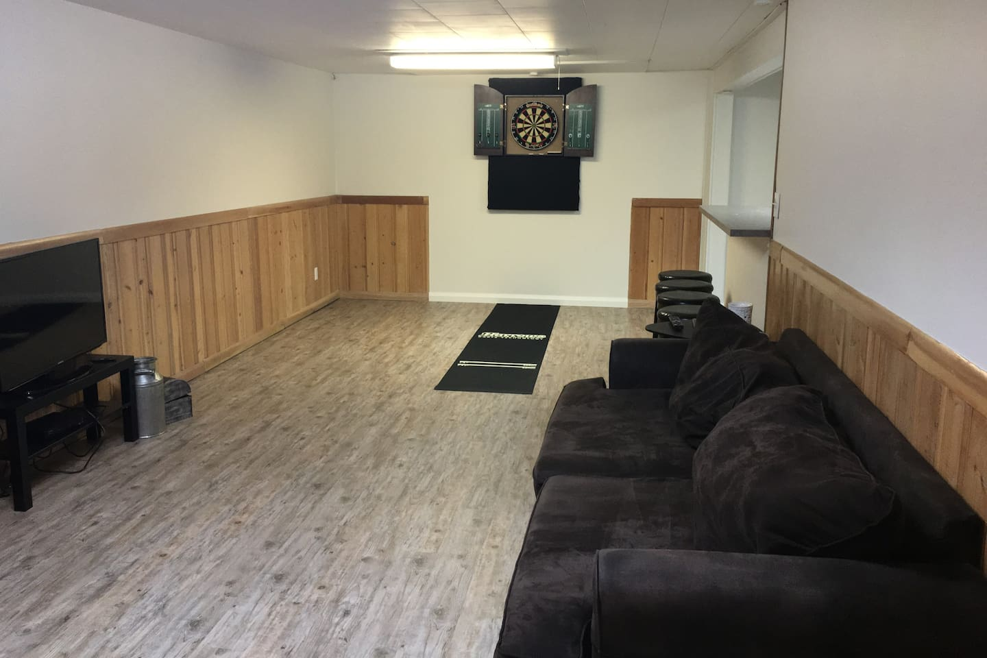 Large open living room with darts board