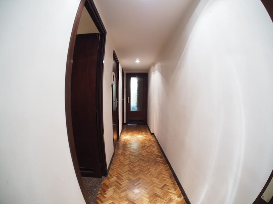 Hallway. First door is the guest room, then you have the kitchen and the last one is the exclusive water closet for our guests.